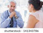 serious doctor listening to... | Shutterstock . vector #141343786