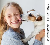 Stock photo happy child with dog portrait girl with pet jack rassell whispers a secret to teen 1413524579