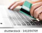 man holding credit card in hand ... | Shutterstock . vector #141354709