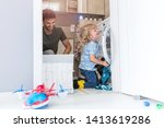 father and son loading washing... | Shutterstock . vector #1413619286