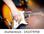 hard rock musicians playing at...