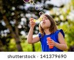 Beautiful Child Blowing Bubbles ...