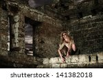 Fantasy style portrait of the scary woman in the ruins - stock photo