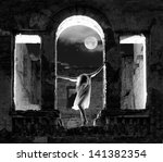 Mysterious female figure standing in the arc of the ruined building in full moon night, black and white shot - stock photo