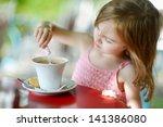 Adorable Girl Pouring Sugar...