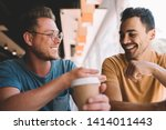 Stock photo excited caucasian hipster guys feeling great during friendly meeting in cafeteria interior for 1414011443