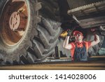 Heavy Machinery Mechanic. Caucasian Technician Under Medium Size Construction Bulldozer.  - stock photo