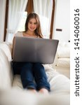 woman using her tablet at home | Shutterstock . vector #1414060016