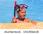 Girl in the swimming pool - stock photo