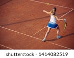 Young Woman Playing Tennis On...