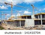 building and cranes under... | Shutterstock . vector #141410704