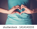 Small photo of Woman hands making a heart shape on her stomach, healthy bowel degestion, probiotics and prebotics for gut health, organ donor day