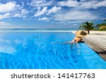 woman in hat relaxing at the... | Shutterstock . vector #141417763