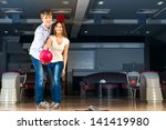 guy hugs her friendgirl ... | Shutterstock . vector #141419980