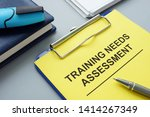 Training Needs Assessment TNA report with clipboard.