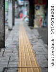 bright yellow tactile footpath... | Shutterstock . vector #1414316003