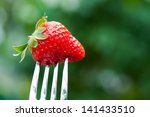 fresh red strawberry on metal...