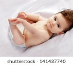 Stock photo portrait of little cute baby on a white background 141437740