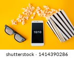 A white smartphone with smilies ...