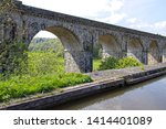 Small photo of Chirk, Wrexham, Wales, UK. 16th May, 2019. A view of part of Chirk Railway Viaduct from the Chirk Aqueduct on a bright sunny day showing viaduct arches.