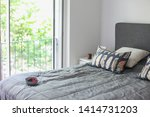a bed in a bedroom with big...   Shutterstock . vector #1414731203