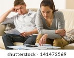 Annoyed Couple Calculating...