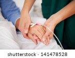 closeup of nurse holding... | Shutterstock . vector #141478528