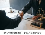 Stock photo businessman shaking hands to seal a deal with his partner lawyers or attorneys discussing a 1414855499
