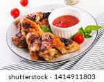 baked chicken wings in the... | Shutterstock . vector #1414911803