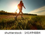 hiker with backpack walking on... | Shutterstock . vector #141494884