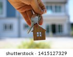 Small photo of Landlord unlocks the house key for new home