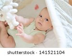 baby playing toys in crib | Shutterstock . vector #141521104