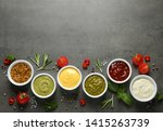 Bowls With Different Sauces An...