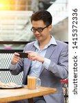happy asian businessman selfie... | Shutterstock . vector #1415372336