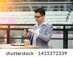 happy asian businessman selfie... | Shutterstock . vector #1415372339