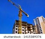 Small photo of Crane. Construction crane. Building crane on the background of building. Construction site.