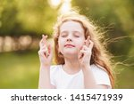 little redhead girl  raises...   Shutterstock . vector #1415471939
