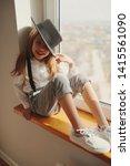 cute little girl with black hat ... | Shutterstock . vector #1415561090