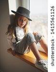 cute little girl with black hat ... | Shutterstock . vector #1415561126