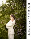 outdoor fashion portrait of...   Shutterstock . vector #1415625530
