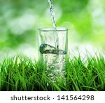 glass of water on nature... | Shutterstock . vector #141564298