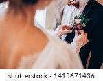 the groom in a suit straightens ... | Shutterstock . vector #1415671436