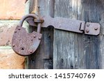 old padlock on old wooden door.   Shutterstock . vector #1415740769