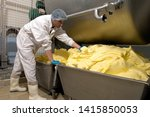 Small photo of Normandie, France, December 2008 Manufacture of industrial butter in a butter industrial churn. Food processing plant.