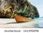 traditional longtail boats in... | Shutterstock . vector #141590098