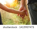 the parent holds the hand of a... | Shutterstock . vector #1415907473