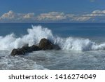 Waves And Surf Breaking Over...