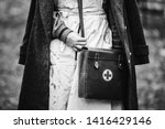 Re-enactor Wears Historical German Nurse Paramedic Of World War II Uniform With First Aid Kit. Photo In Black And White Colors. WWII WW2.