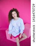 curly hair girl in blue blouse... | Shutterstock . vector #1416470729