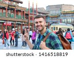Tourist In Asia Showing Peace...